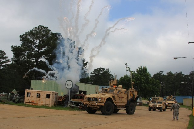 A simulated explosion at a mock Afghan village was part of a training mission thread for the 3rd Brigade Combat Team, 10th Mountain Division (Light Infantry), at the Joint Readiness Training Center at Fort Polk, La., earlier this summer, in preparation for the unit's deployment. The WIN-T Increment 2 Soldier Network Extension-equipped vehicle (front center) enabled Soldiers to relay information throughout the brigade and increase operational tempo. The unit will join the 4th BCT, 10th Mountain Division, in theater this fall, where both BCTs will use CS 13 in support of their advise-and-assist and retrograde missions.
