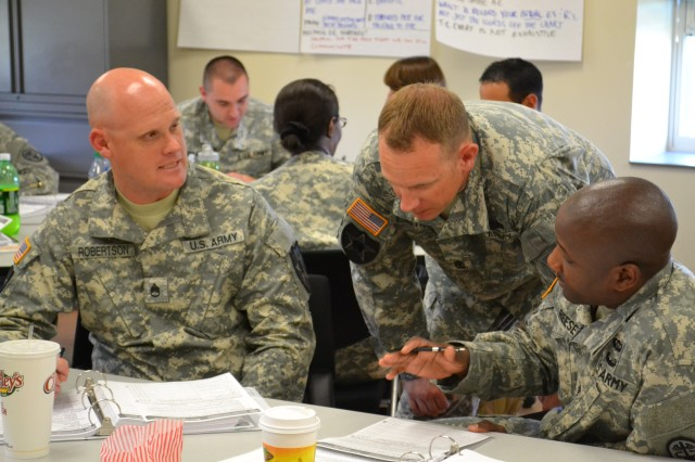 Soldiers practice resilience skills during a breakout session at the Master Resilience Trainer course at Joint Base Lewis-McChord, Wash., June 2013.