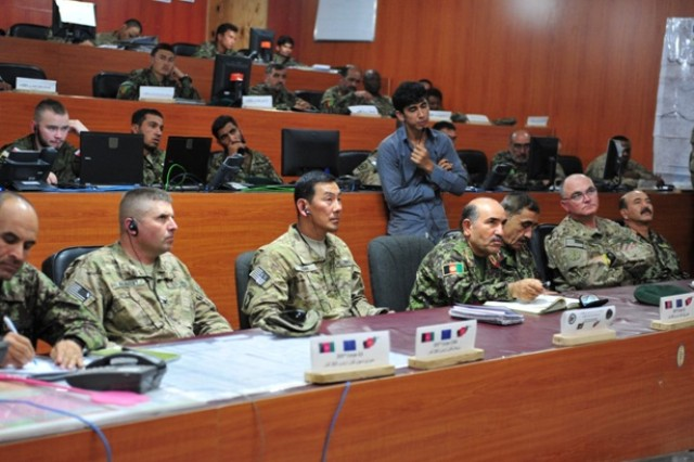 Col. Val C. Keaveny, Brig. Gen. K. K. Chinn and Maj. Gen. M. Sharif Yaftali (ANA 203rd Corps) attend a brief by the 203rd Corps staff on July 31, 2013.