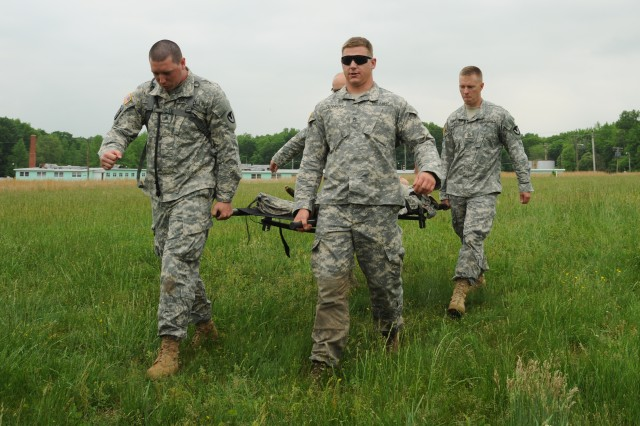 Staff Sgt. Joshua Menninger, CERDEC NVESD, and fellow RDECOM Noncommissioned Officers train on medical-evacuation procedures May 20 as part of the week-long RDECOM NCO of the Year competition.
