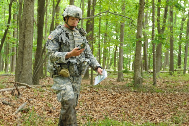 Staff Sgt. Joshua Menninger, CERDEC NVESD, makes his way through the land-navigation course as part of the RDECOM NCO of the Year competition at Lauderick Creek Training Site, Aberdeen Proving Ground, Md., May 20.