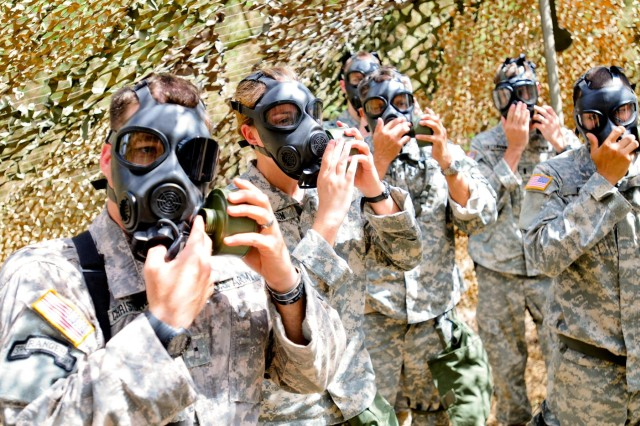 Soldiers from 3rd General Support Aviation Battalion, 25th Aviation Regiment, 25th Combat Aviation Brigade, 25th Infantry Division, practice replacing their air filter canister on the pro-mask during the chemical, biological, radiological, nuclear training lane during the 3-25 AVN field training exercise near Dillingham Airfield, Hawaii, Aug. 6.