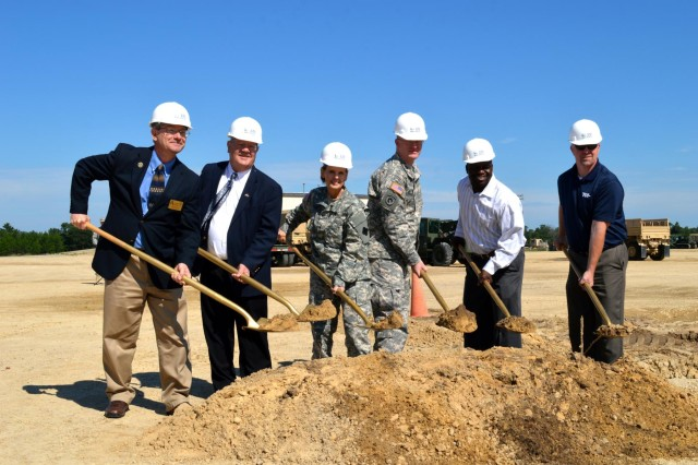 Maj. Gen. Karen E. LeDoux, 88th Regional Support Command commanding general (center left), Command Sgt. Maj. David J. Unseld, 88th RSC command sergeant major (center right), Wisconsin Army Reserve Ambassador Gerald Meyer, and representatives from KEPA-TCI (Architects, Engineers, Contractor of La Crosse, Wis.) Joint Venture LLC break dirt with gold shovels for the $19 million tactical equipment maintenance facility at Fort McCoy, Wis. (Photo by Sgt. Brittany Zold)