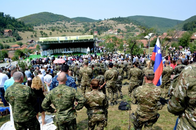 Kosovo Force soldiers attend Mass outside the Church of the Black Madonna Aug. 15. For the last 400 years, people throughout the Balkans have been making the pilgrimage to the church to celebrate the Feast of the Assumption of the Blessed Virgin Mary. (U.S. Army photo by Capt. Randy Ready, 4th Public Affairs Detachment)