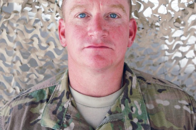 U.S. Army Command Sgt. Maj. Corey Gill, the senior enlisted adviser for Headquarters and Headquarters Battalion, 4th Infantry Division, pictured at Kandahar Airfield, Afghanistan, Aug. 15, 2013.  (U.S. Army National Guard photo by Staff Sgt. Scott Tynes/Released)