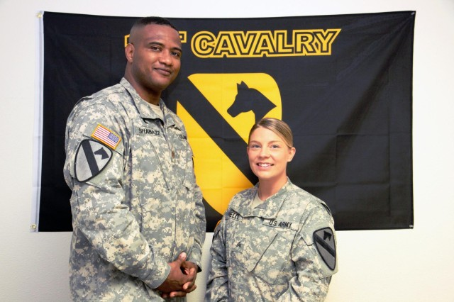 "Maj. Khallid Shabazz, an Alexandria, La., native and chaplain for the 1st Air Cavalry Brigade, 1st Cavalry Division, and Sgt. Jessica N. Covello, a San Antonio native and 1st ACB chaplain assistant pose for a photo in their office at Fort Hood, Texas, Aug. 8. Comprising the unit ministry team for 1st ACB, the two held a Ramadan fast-breaking service for more than 60 soldiers and family members at ""The Ohana Place"" 19th Street Chapel here, Aug. 6."