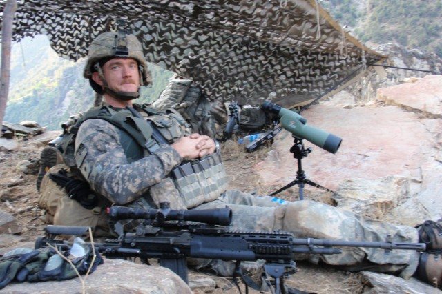 Then-Spc. Ty Carter mans a position in Afghanistan. After losing eight members of his unit in a fierce battle at Combat Outpost Keating, Carter resisted counseling for post-traumatic stress disorder, but now credits it with saving him.