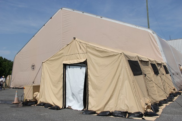 Operators enter and exist the enclosure through the Personnel Decontamination Station, where emergency response personnel are onsite and prepared to enter the operations area in the event an upset condition occurs within the enclosure.