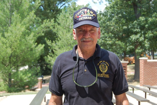 A Vietnam veteran and former U.S. Army Military Police Soldier, Bob Clement, revisits his MP roots during the 2013 National Law Enforcement Explorer Academy graduation, July 19, on Fort Leonard Wood's MP Memorial Grove.