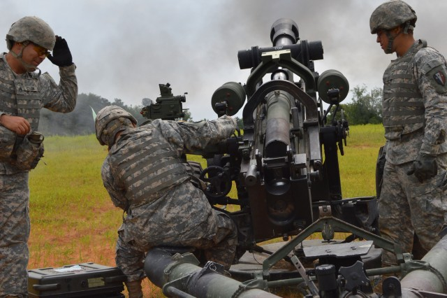 New Jersey Guardsmen from Alpha Battery, 3rd Battalion, 112th Field Artillery Regiment send a round downrange during a live fire exercise at Fort Pickett, Va. The 50th Infantry Brigade Combat Team unit are being validated, to ensure their readiness as part of the Army Force Generation cycle during which they may be called to mobilize in support of operations around the world. (U.S. Army photo by Sgt. 1st Class Stephanie Widemond, 188th Infantry Brigade Public Affairs)