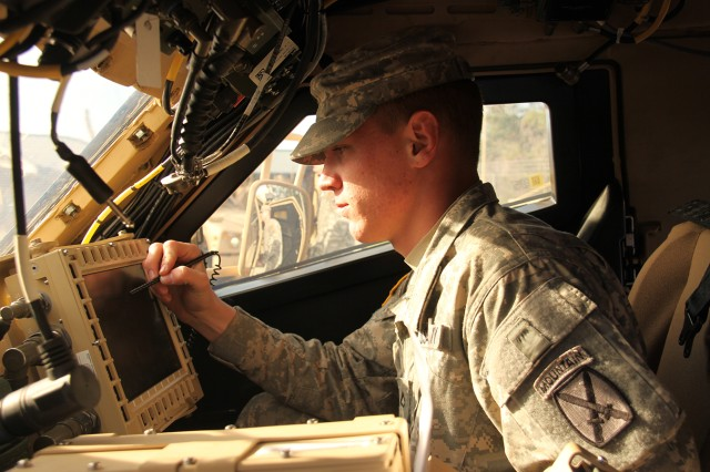 A 10th Mountain Division Soldier trains with elements of the CS 13 communications network before deploying with the equipment to Afghanistan this summer.