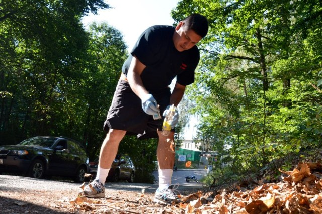 Army Staff Sgt. Javier, Hernandez, a cadre member at Landstuhl's Medical Transient Detachment, cleans up trash outside Wilson Barracks in Landstuhl as part of a biannual event organized by the Sgt. Audie Murphy Club at Landstuhl Regional Medical Center. (photo by Rick Scavetta, U.S. Army Garrison Kaiserslautern)