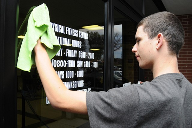 Justin Roberts cleans the windows at the physical fitness facility on Andrews Avenue in February as part of a previous Hired! Apprenticeship Program.