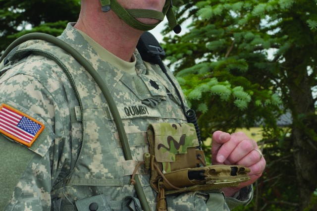 Lt. Col. Kenneth Quimby, former chief of the Field Logistics Support Directorate's Readiness Training Division, demonstrates how the Nett Warrior end user device is worn and used by Soldiers in the field.
