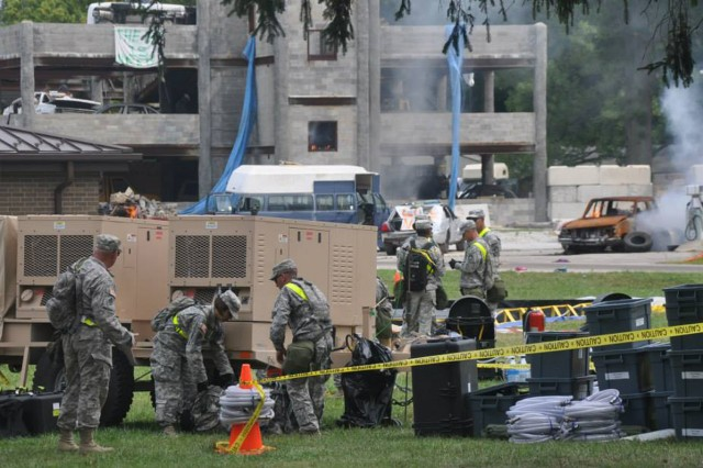 Task force operations Soldiers set up decontamination site for training during Vibrant Response at Muscatakuck Urban Training Complex, Ind.