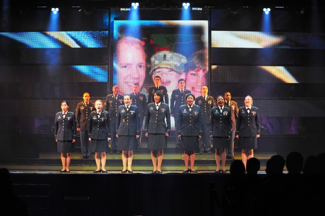 """PRESIDIO OF MONTEREY, Calif. -- The entire cast of Soldier Show performers come together to sing """"Carry On"""" during the show's climax at the Price Fitness Center on Aug. 16."""