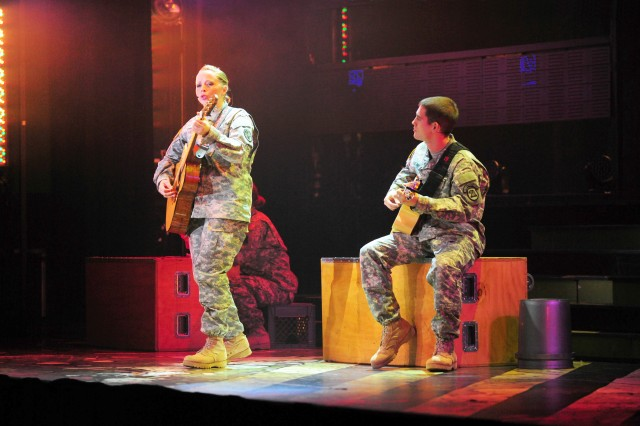 """PRESIDIO OF MONTEREY, Calif. -- Spc. Kelly Greg and Sgt. Alexander Rebling play guitars while performing a duet of """"Dream On."""""""