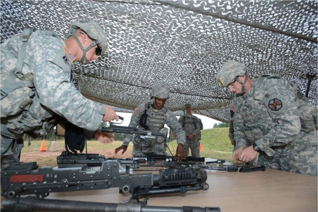 (From left to right) U.S. Army Sgt. Timothy Smell II, assigned to U.S. Army Europe Headquarters Battalion, Spc. Ernestine Koroma, assigned to 212th Combat Support Hospital and Sgt. Bryan Teneyck, assigned to Installation Management Command-Europe, conduct the weapons assembly lane during U.S. Army Europe's Best Warrior Competition in Grafenwoehr, Germany, Aug. 19, 2013. The competition is a weeklong event that tests Soldiers' physical stamina, leadership and technical knowledge and skill. Winners in the Soldier and Noncommissioned Officer categories of the USAREUR competition will go on to compete at the Department of the Army level.