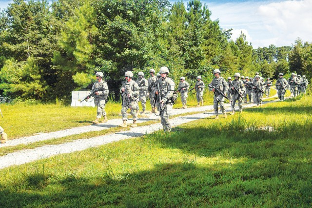 The main body of the 266th Quartermaster Battalion moves iinto the Brigade Support Area during the 23rd QM Brigade field training exercise Aug. 13. The exercise was moved from Fort A.P. Hill after a near three-year stay.