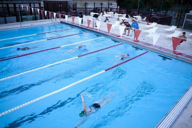 Participants swim 1.2 miles while counters count the number of laps during the Half Iron Swim at the Maj. Douglas A. Zembiec Pool on the Henderson Hall portion of Joint Base Myer-Henderson Hall the morning of Aug. 21.