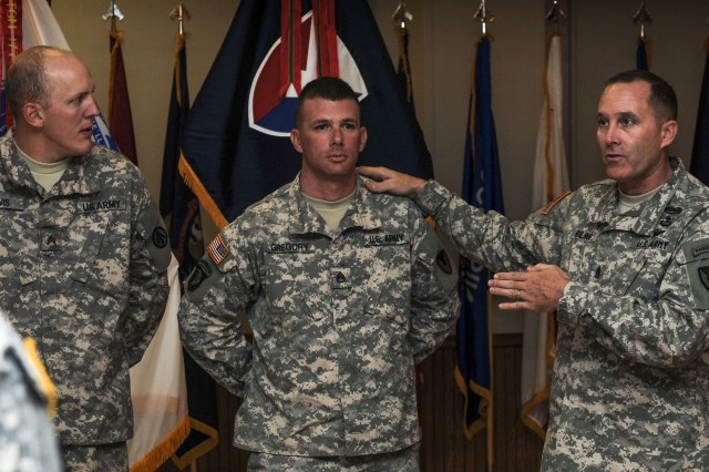 Army Materiel Command's Command Sgt. Maj. Ronald Riling announces the AMC Noncommissioned Officer of the Year, Staff Sgt. Andrew Gregory (center), U.S. Army Sustainment Command, and AMC Soldier of the Year, Sgt. Ryan Lewis, Military Deployment and Distribution Command, during a ceremony on Rock Island Arsenal, Ill., Aug. 22.   Gregory and Lewis will represent the command at the Department of the Army Best Warrior Competition in October at Fort Lee, Va.