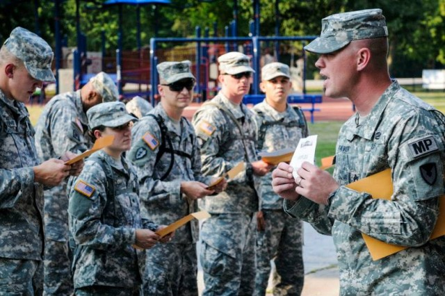 Army Sustainment Command's Sgt. 1st Class Matthew Favory briefs Soldiers competing in the 2013 Army Materiel Command Best Warrior Competition during the urban orienteering event, Aug. 20.