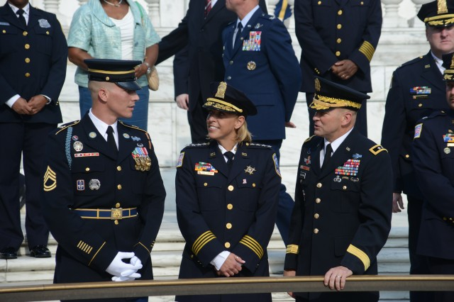 Maj. Gen. Jeffrey S.Buchanan, JFHQ-NCR/MDW commanding general, and Metropolitan Police Department Chief of Police, Cathy L. Lanier speak with Sgt. 1st Class Tanner M. Welch, Sergeant of the Guard, prior to the Changing of the Guard at the Tomb of the Unknown Soldier at Arlington National Cemetery, August 21, 2013.