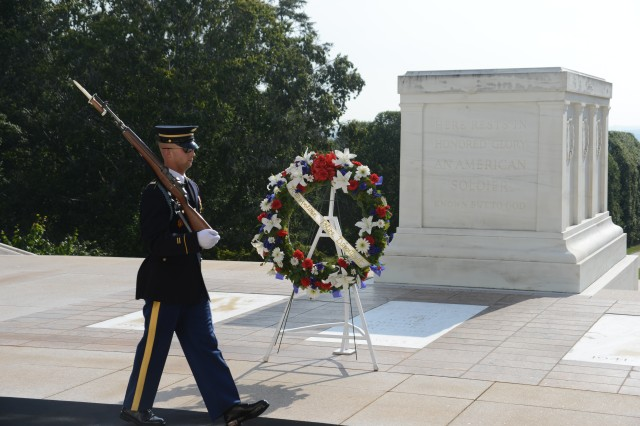 A Tomb Sentinel guards the Tomb of the Unknown Soldier following an Army Full Honors wreath laying ceremony by Metropolitan Police Department, Chief of Police Cathy L. Lanier at the Tomb of the Unknown Soldier at Arlington National Cemetery August 21, 2013.