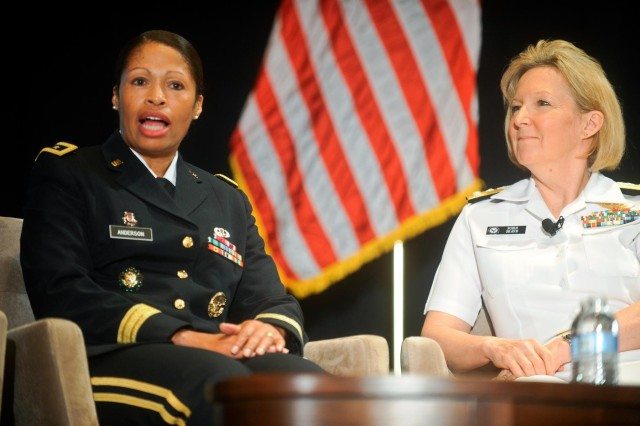 Maj. Gen. Marcia Anderson, left, representing the Army Reserve on behalf of its chief, and Navy Vice Adm. Robin Braun, right, the chief of the Navy Reserve, participate in the Reserve chiefs panel at the Reserve Officers Association National Security Symposium, Washington, D.C., Aug. 9, 2013.