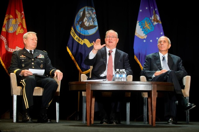 (From left to right) Gen. Frank Grass, the chief of the National Guard Bureau and a member of the Joint Chiefs of Staff, retired Marine Corps Maj. Gen. Arnold Punaro, moderator, and Walker Williams, the president of the Reserve Officers Association, participate in the Reserve chiefs panel at the Reserve Officers Association National Security Symposium, Washington, D.C., Aug. 9, 2013.