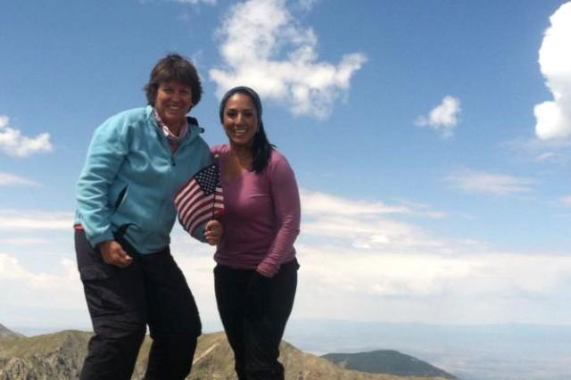 Bev Stotz, left, and Stella Juarez celebrate reaching the summit of Wheeler Peak, N.M., Aug. 17.