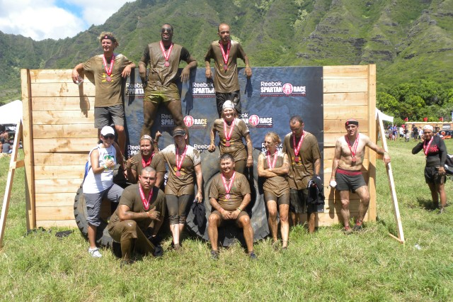 "The Mighty Masticators endured, barbed wire, uphill runs, tire flips and rope climbs "" all while covered head-to-toe in mud."