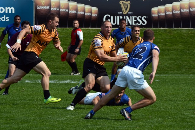 Maj. Nate Conkey of Joint Base Lewis-McChord, Wash., scores the first try for All-Army during the Soldiers' 26-7 victory over All-Air Force in the teams' first meeting of the 2013 Armed Forces Rugby Championships, Aug. 16, 2013, at Infinity Park in Glendale, Colo.
