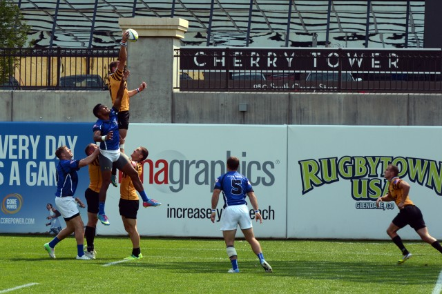 Second Lt. Will Holder of Fort Sill, Okla., snags the ball as All-Army soars to a 26-7 victory over All-Air Force in the teams' opening match of the 2013 Army Forces Rugby Championships, Aug. 16, 2013, at mile-high Infinity Park in Glendale, Colo.