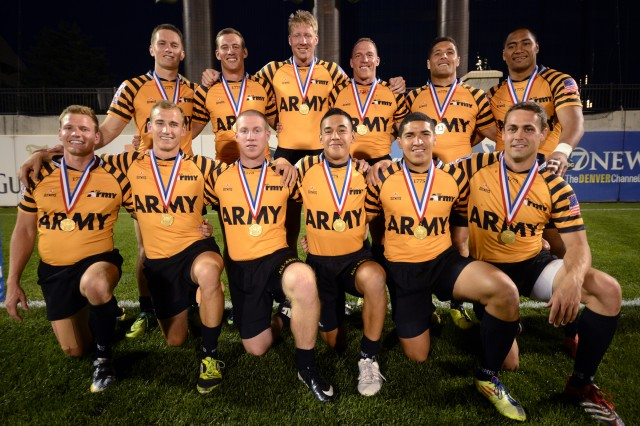 All-Army Rugby players exhibit gold medals after winning the 2013 Armed Forces Rugby Sevens Championship with a 19-14 victory over All-Air Force in the title game Aug. 17 at Infinity Park in Glendale, Colo.