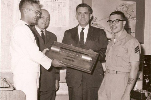 Col. Charles Fitzgerald (third from left) poses for a photo sometime in 1965, when he departed as MoLink's first chief. To the left are Navy Cryptologic Technician Harry Radkfeldt and Maj. Glenn Nordin and to the right is Marine Sgt. Wayne Meech.