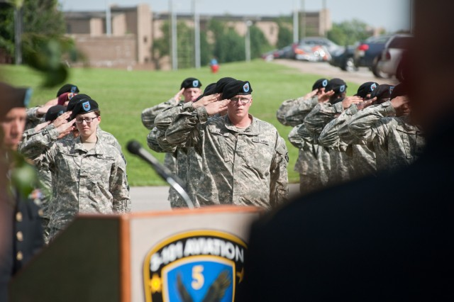 The Soldiers of 5th Battalion, 101st Combat Aviation Brigade, 101st Airborne Division (Air Assault) render honors during the playing of Taps at a ceremony to dedicate two trees to fallen comrades at Fort Campbell, Ky., August 9, 2013. (U.S. Army photo by Sgt. Duncan Brennan, 101st CAB Public affairs)