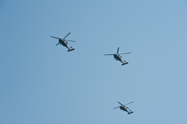 Pilots with 5th Battalion, 101st Combat Aviation Brigade, 101st Airborne Division (Air Assault) fly the missing man formation during a memorial ceremony at Fort Campbell, Ky., August 9, 2013. The two helicopters in the lead will continue flying as the trail helicopter peels away from the formation signifying the loss of a fellow Soldier. (U.S. Army photo by Sgt. Duncan Brennan, 101st CAB Public Affairs)