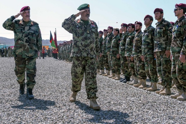 Afghan National Army Brig. Gen. Abdul Karim (left), commando commander, 1st ANA Special Operations Brigade, and ANA Maj. Gen. Abdul Khaliq, deputy chief of the army, salute a formation of ANA commandos during the activation ceremony for the 1st ANA Special Operations Brigade at Forward Operating Base Thunder,  Aug. 20, 2013. The formation of the brigade is a large step forward in turning over full security of Afghanistan to the Afghan National Security Forces before the Coalition Forces drawdown scheduled for late next year. (U.S. Army National Guard photo by Spc. Ryan Scott, 129th Mobile Public Affairs Detachment/Released)