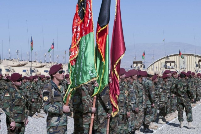 Afghan National Army commandos with the 1st ANA Special Operations Brigade Color Guard display the flags of Afghanistan, the ANA 203rd Corps, and 1st ANA Special Operations Brigade during the brigade's formation ceremony at Forward Operating Base Thunder, Aug. 20, 2013. The formation of the brigade is a large step forward in turning over full security of Afghanistan to the Afghan National Security Forces before the Coalition Forces drawdown scheduled for late next year. (U.S. Army National Guard photo by Spc. Ryan Scott, 129th Mobile Public Affairs Detachment/Released)