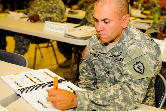 Staff Sgt. Giancarlo Ramos, squad leader with Company B, 2nd Battalion, 27th Infantry Regiment, 3rd Brigade Combat Team, 25th Infantry Division, highlights information about victims' rights during an 80-hour Sexual Harassment and Assault Response Prevention certification course on Wheeler Army Airfield, Hawaii, Aug. 13.
