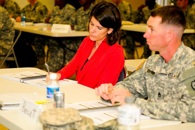 Jessica Lynch, U.S. Army Garrison sexual response coordinator, jots down notes about the responsibilities the victim advocate has with each victim during an 80-hour Sexual Harassment and Assault Response Prevention certification course on Wheeler Army Airfield, Hawaii, Aug. 13.