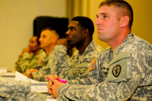Staff Sgt. Anthony Stegmeier, squad leader with Company C, 1st Battalion, 21st Infantry Regiment, 2nd Stryker Brigade Combat Team, 25th Infantry Division, soaks in knowledge about the boundaries between the victim and victim advocate during an 80-hour Sexual Harassment and Assault Response Prevention certification course on Wheeler Army Airfield, Hawaii, Aug. 13.