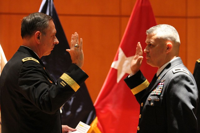 Newly promoted Brig. Gen. Richard Torres, deputy commanding general, 80th Training Command (TASS), takes the oath of office administered by Maj. Gen. (ret.), John McLaren former 80th TC commander. The oath took place during Torres's promotion ceremony at the North Carolina National Guard and North Carolina State Emergency Operations Center Joint Facility, Raleigh, N.C., on August 24, 2013.