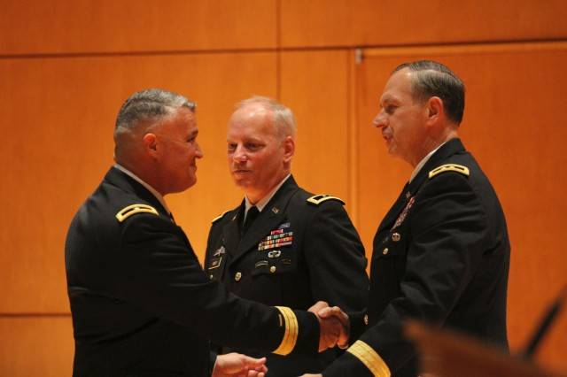 Maj. Gen. Bill Gerety, commanding general 80th Training Command (TASS), and Maj. Gen. (ret.) John McLaren, Jr., former commanding general, 80th Training Command (TASS), congratulate newly promoted Brig. Gen. Richard Torres during his promotion ceremony at the North Carolina National Guard and North Carolina State Emergency Operations Center Joint Facility, Raleigh, N.C., on August 24, 2013. Torres has been serving as the deputy commanding general for the 80th Training Command (TASS) since May 25, 2013.