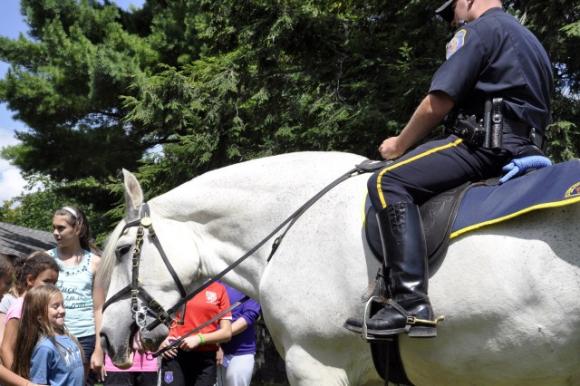 """City of Albany Mounted Police Officer Andrew Dwyer edges """"Sam"""" ever so gently to the kids.  Dwyer, and fellow Albany Mounted Police Officers, John Dwyer and Kurt Johnson, supported the arsenal's summer camp as a way to excite the kids, while reinforcing the image of police officers in a positive light."""