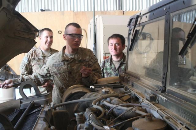 Vanguard mechanics help Afghan National Army repair vehicles ...