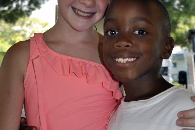 Molly Sheldon and Hillel Powell show that there is never a shortage of smiles and new friendships at the arsenal's summer camp.