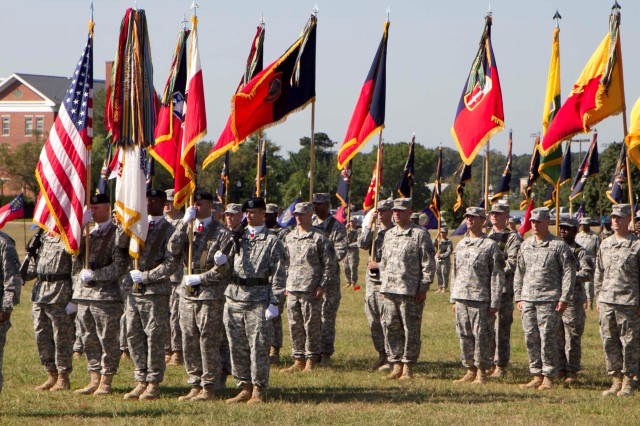First Army Division East Chief of Staff, Col. Tracy O. Smith, on behalf of the Division, salutes his new commander, Maj. Gen. Jeffrey L. Bailey, at the conclusion of the Aug. 26 change of command ceremony on the Parade Field at Fort George G. Meade Md.