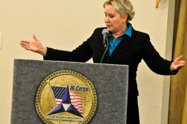 Dr. Diane Howard, retired University of Mary Hardin-Baylor professor of Performance Studies, speaks on the history of women's rights to a host of Soldiers and civilians during the Fort Hood Women's Equality Day observance at Club Hood on Fort Hood, Texas, August 26. Howard is also an accomplished actress, producer, scholar and author. (Photo by Staff Sgt. Tony Foster, Division West Public Affairs)